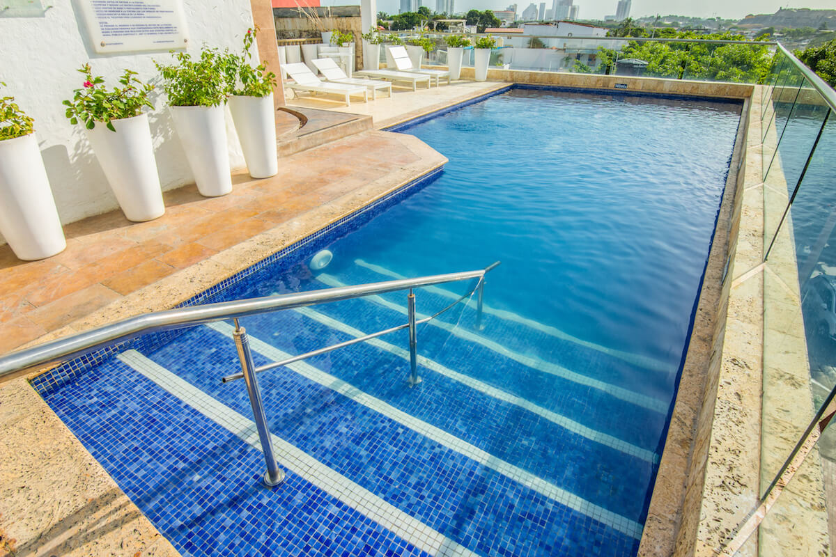 Outdoor swimming pool GHL Collection Armería Real Hotel